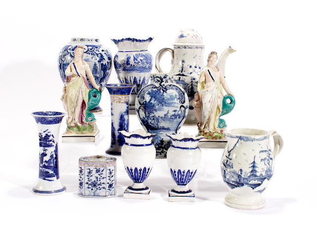 A group of British pottery, two Staffordshire figures, two Dutch Delft vases and a Chinese blue and white tea canister, late 18th and 19th century