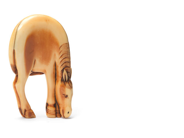 An ivory netsuke of a grazing horse 18th century