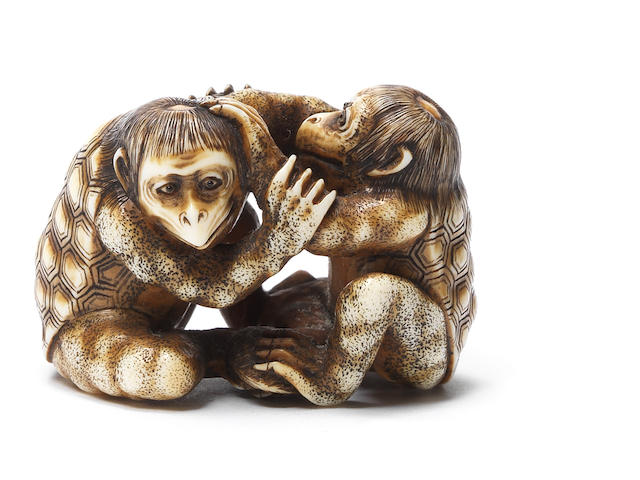 A rare ivory netsuke of two kappa By Ikkosai Toun, Edo, 19th century