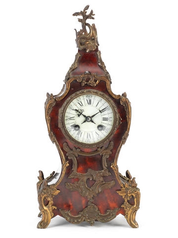 A late 19th century tortoiseshell and brass mounted Boulle type clock