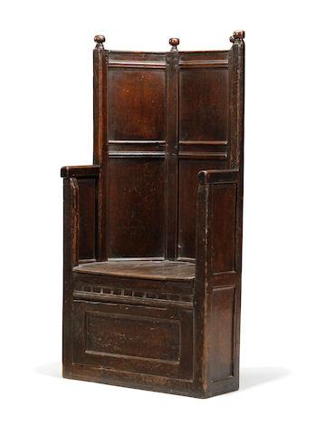 A Welsh 18th century oak panel back armchair