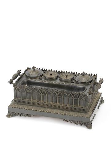 A Regency Neo-Gothic bronze desk stand