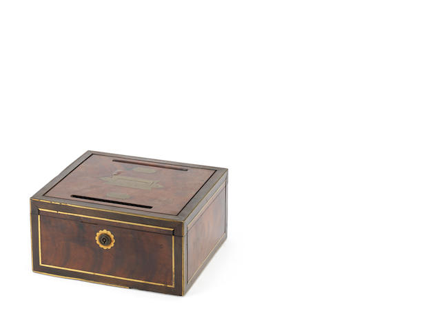 An mid 19th century mahogany and brass letter box