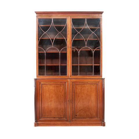 A late George III mahogany and satinwood banded library bookcase in the manner of Gillows