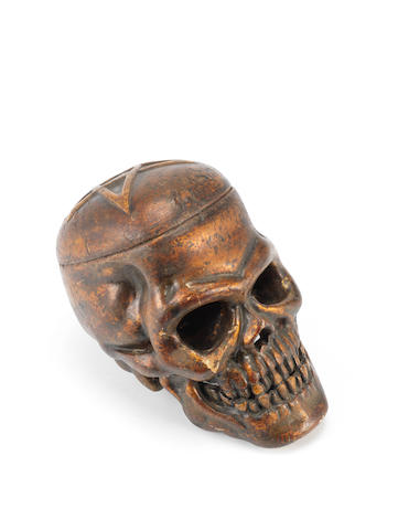 A giltwood carved skull