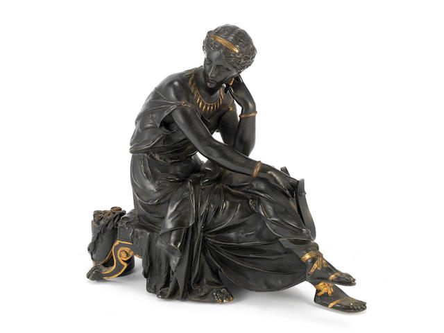 A late 19th century French bronze and parcel gilt model of a seated Sappho in the style of Jean-Jacques Pradier, (French, 1790-1852)
