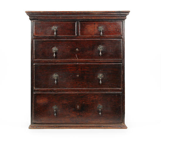 An early 18th century miniature chest of drawers Probably once on a stand