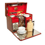 A leather cased picnic set for two persons, by J C Vickery, circa 1909,