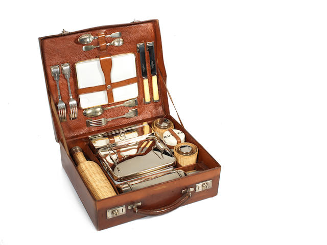 A leather cased picnic set, by Barratt,
