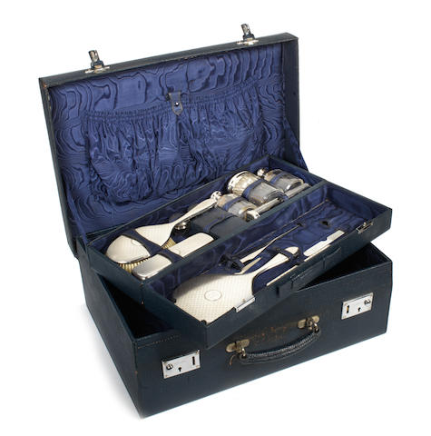 A pre-War leather cased vanity set with sterling silver accessories, British,