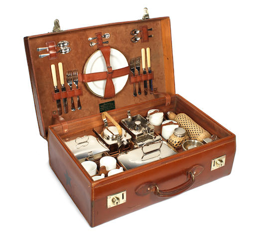 A leather-cased picnic set for four persons, by John Pound & Co., London, 1920s,