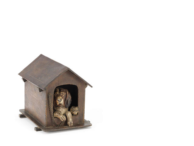 A late 19th century Viennese cold painted bronze inkwell modelled as two dogs in a kennel After the painting Dignity and Impudence by Sir Edwin Henry Landseer, English (1802‑1873)