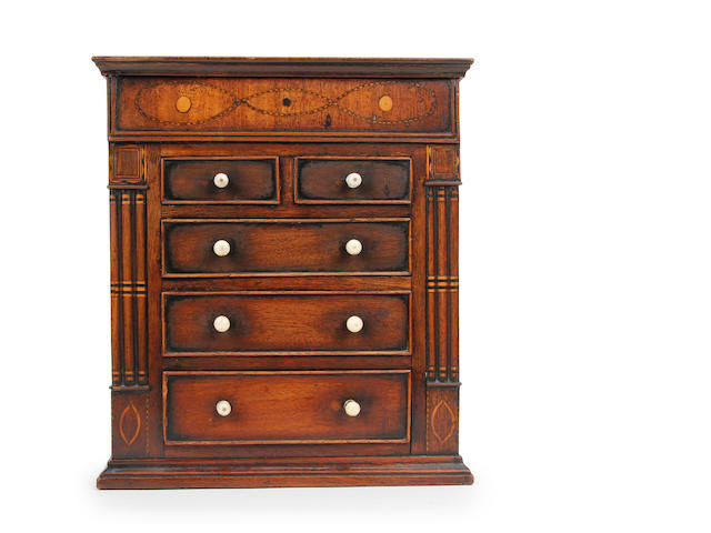 An early 19th century mahogany and inlaid miniature chest