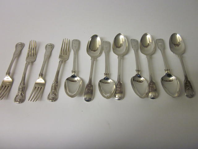 A matching set of eight Irish silver fiddle and thread pattern dessert spoons, Dublin 1832, 1844  (12)