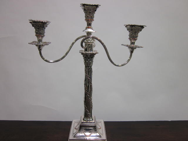 An Old Sheffield plate two branch three light candelabrum,