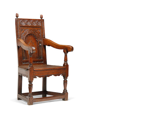 A James I oak and inlaid panel back open armchair
