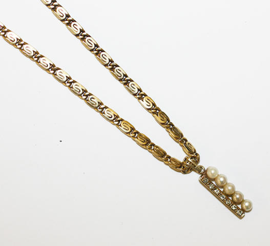 A fancy-link chain with cultured pearl pendant