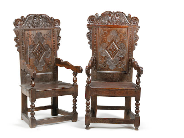 A pair of Charles II oak panel back open armchairs, Yorkshire Bradford/Halifax area
