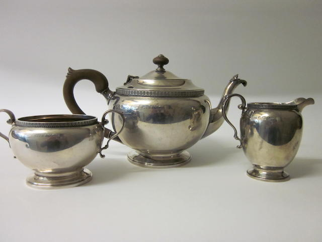A silver three piece tea service,  by Reid and Sons,  Birmingham 1931,   (3)