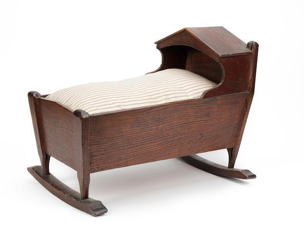 An oak doll's cradle