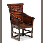 A late 17th century oak enclosed armchair
