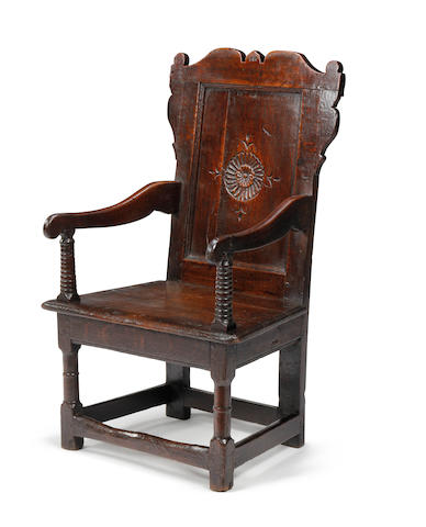 A Charles II oak panel-back open armchair Circa 1660