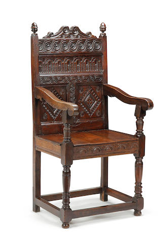 An oak triple panel-back open armchair, Lancashire Incorporating some 17th century timbers