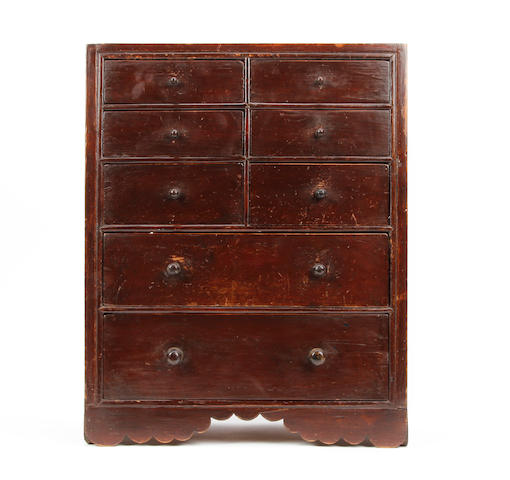 A mid-19th century stained and painted pine miniature chest of drawers