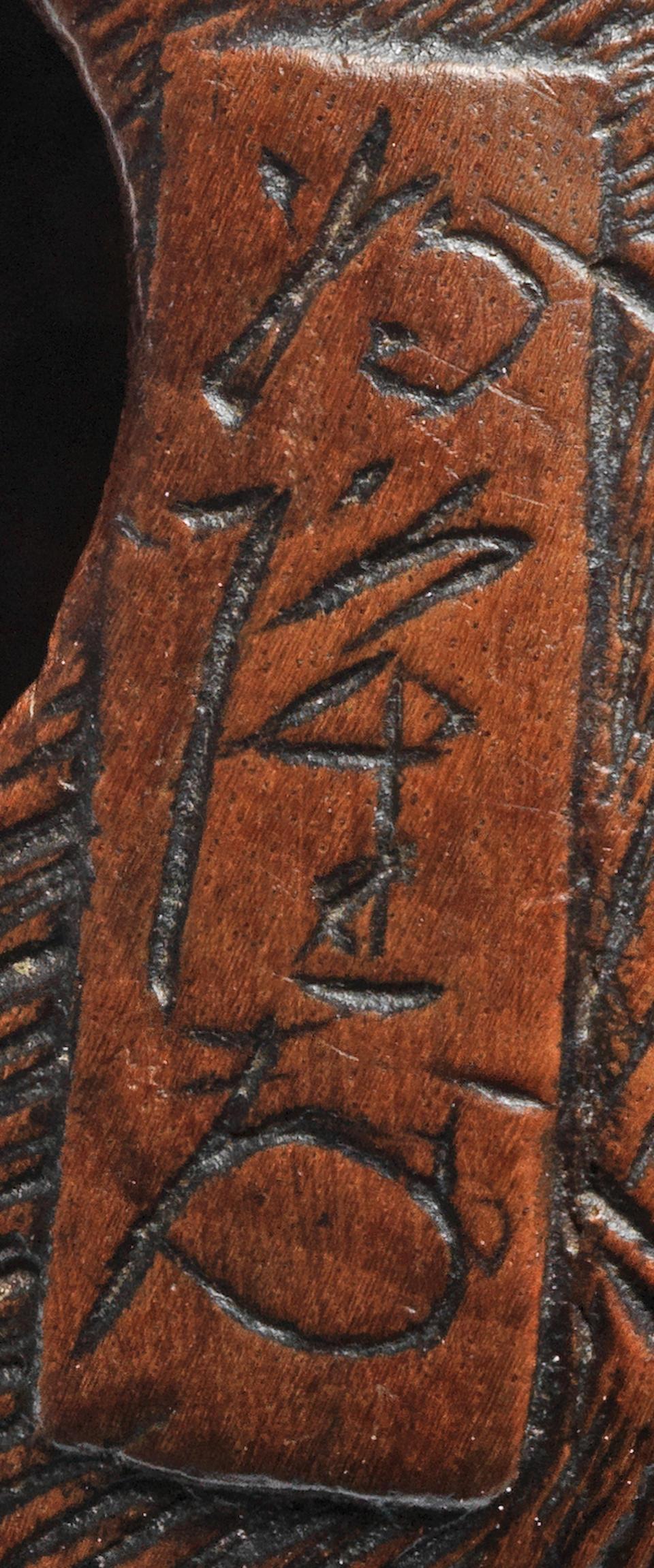 A wood netsuke of a tiger By Tametaka, Nagoya, 18th century