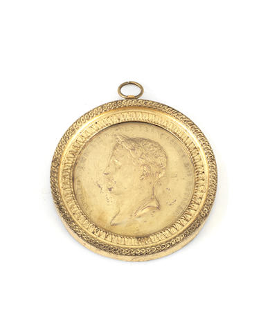 An early 19th century Empire ormolu medallion depicting Napoleon