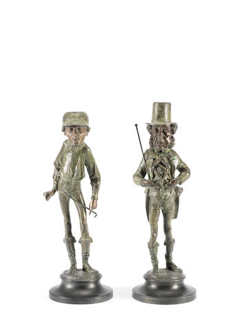 A pair of spelter figural candlesticks