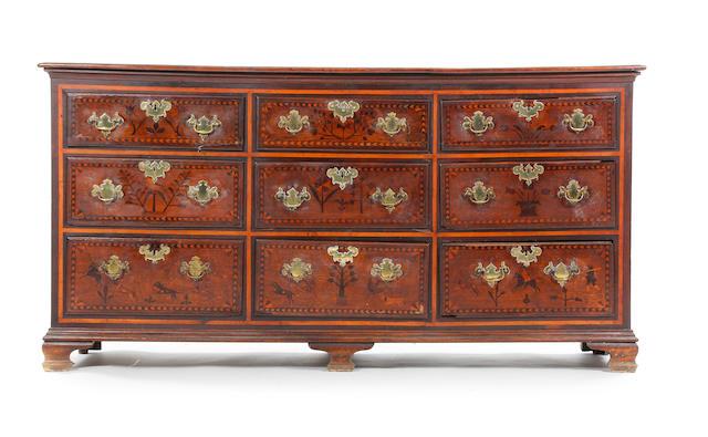 A mid 18th Century inlaid oak dresser