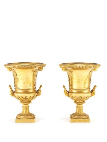 A pair of Empire 19th century gilt bronze urns