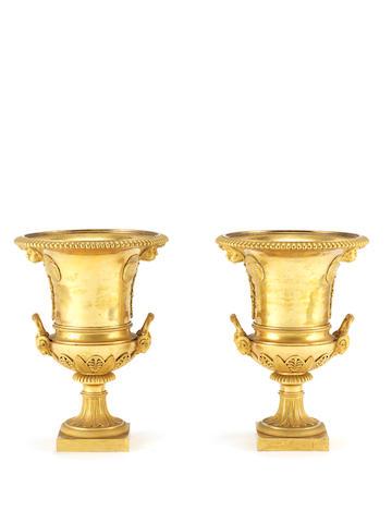 A pair of Empire 19th century gilt bronze urns