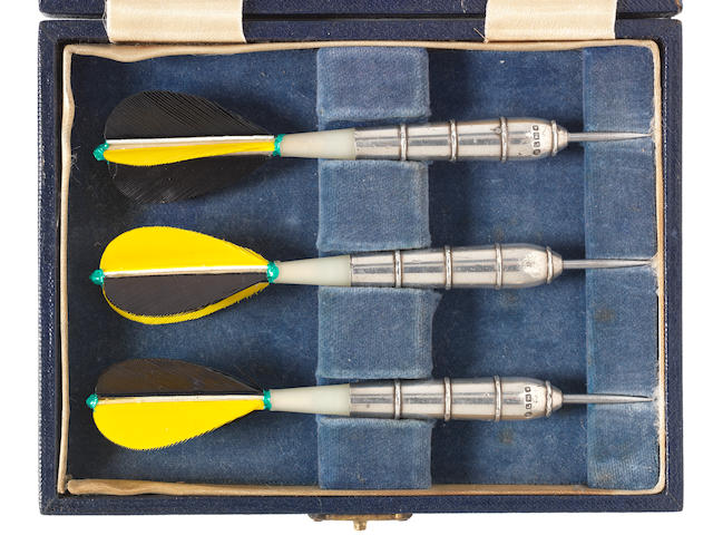 An unusual cased set of three silver mounted playing darts by John Pinches Ltd, London 1946