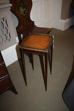 An Edwardian mahogany and satinwood kettle stand