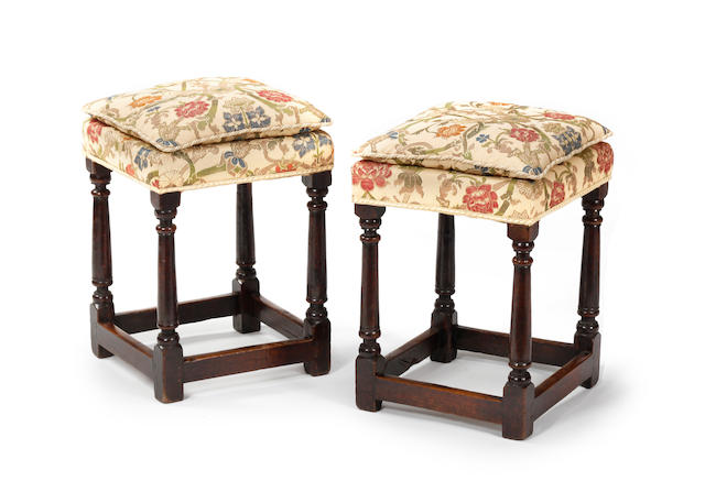 A pair of oak and upholstered stools In the 18th century manner