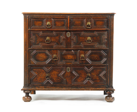 A Charles II oak geometric chest of drawers