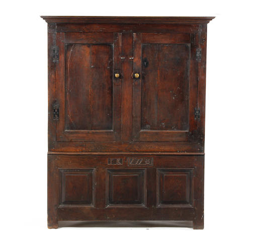 An oak livery cupboard 18th century, with adaptations