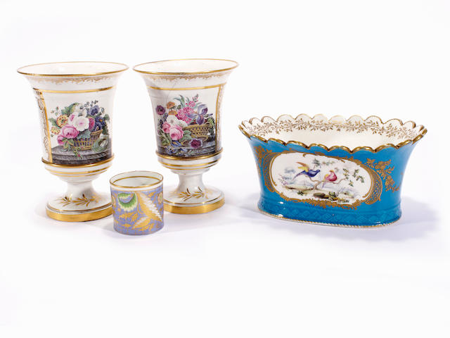 A pair of London-decorated vases, a jardiniere with Sevres style decoration and a coffee can, 19th century