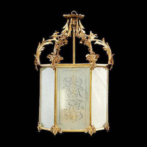 A Victorian Rococo Revival gilt brass and frosted glass hall lantern
