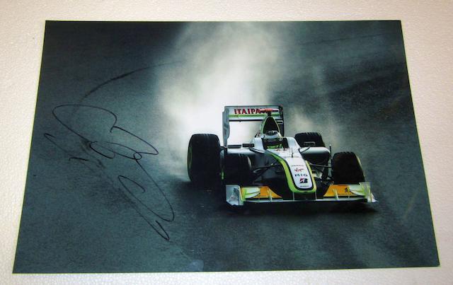 A Jenson Button signed print.