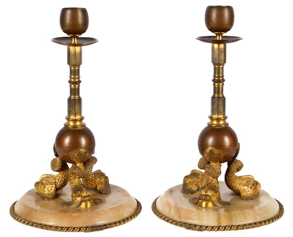 A pair of early 20th Century French gilt bronze and onyx candlesticks
