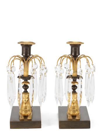 A pair of mid 19th century Egyptian Revival lustre candlesticks