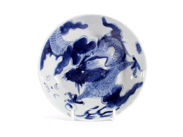 A small blue and white dragon dish
