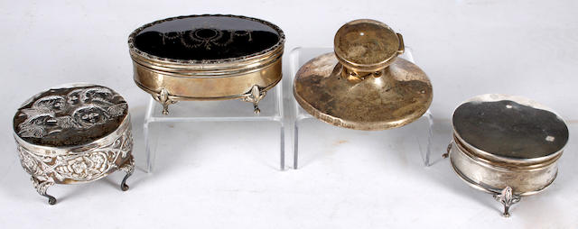 A silver and tortoiseshell mounted oval trinket box,Birmingham 1919, also two further silver trinket boxes and a capstan inkwell (4).