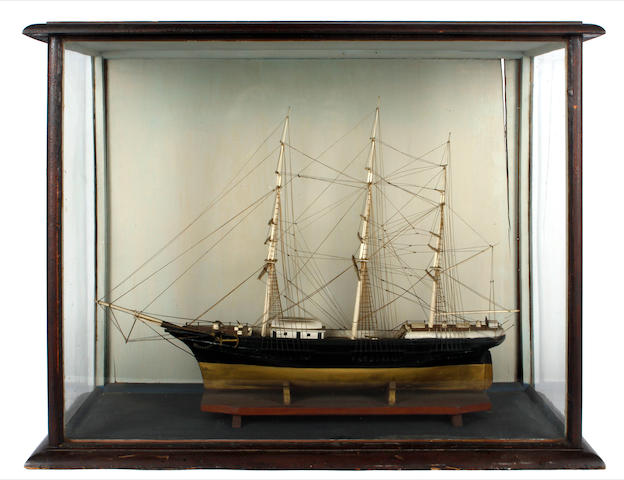 A cased model of a three masted ship, 63cm wide