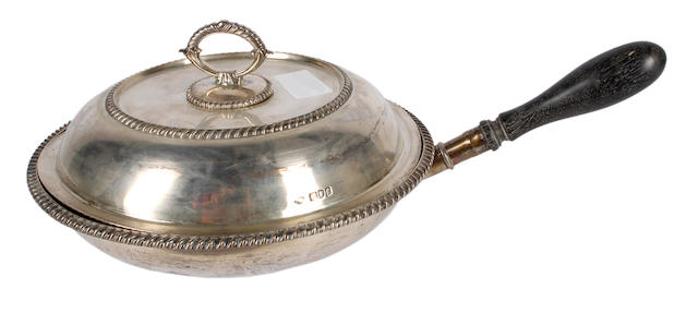 A silver vegetable dish with divisioned interior