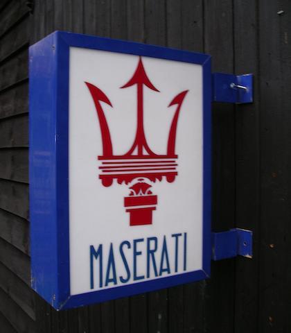 A hand-painted 'Maserati' illuminating garage display sign,