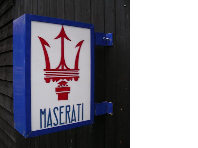 A hand-painted 'Maserati' illuminating garage display sign,